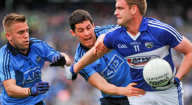 Donal Kingston, Laois, in action against Jonny Cooper, left, and Rory O'Carroll