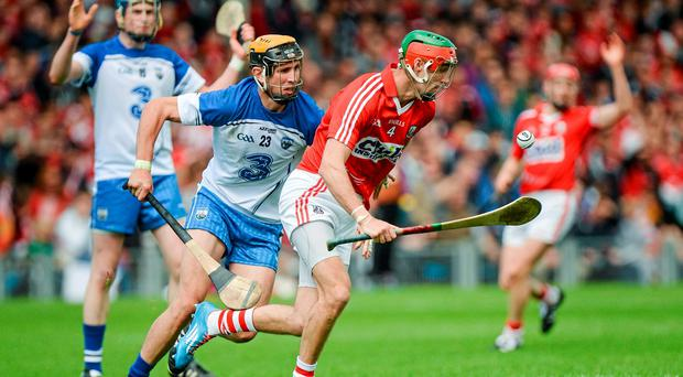 Stephen McDonnell, Cork, in action against Maurice Shanahan, Waterford