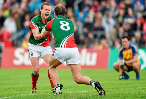 Mayo's Andy Moran (left) and Aidan O'Shea celebrate victory over Roscommon after the game at Dr Hyde Park. Photo: Barry Cregg / SPORTSFILE