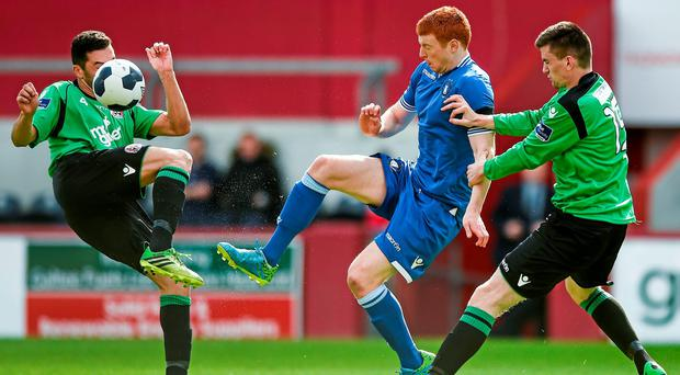 Rory Gaffney, Limerick FC, in action against Roberto Lopes and Dan Byrne, Bohemians