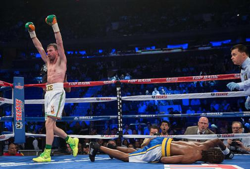 Andy Lee celebrates his knock out of John Jackson of the U.S. in the fifth round of their USNBC Super Welterweight title bout