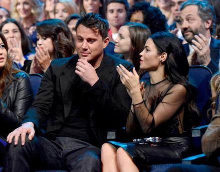 Actors Channing Tatum (L) and Jenna Dewan Tatum attend the 2014 MTV Movie Awards at Nokia Theatre L.A. Live on April 13, 2014 in Los Angeles, California. (Photo by Kevin Mazur/WireImage)