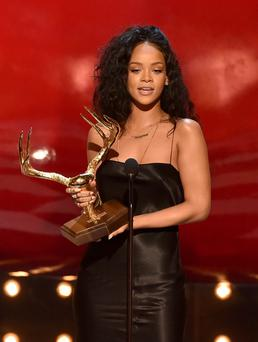 Singer Rihanna accepts the Most Desirable Woman award onstage during Spike TV's