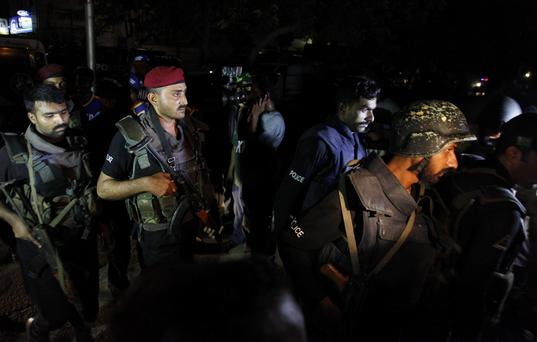 Pakistani commandos get ready to enter Karachi airport terminal following attacks by unknown gunmen on Sunday night