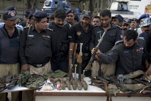 Pakistani police officers display ammunition confiscated from attackers at the Jinnah International Airport, Monday, June 9, 2014, in Karachi, Pakistan