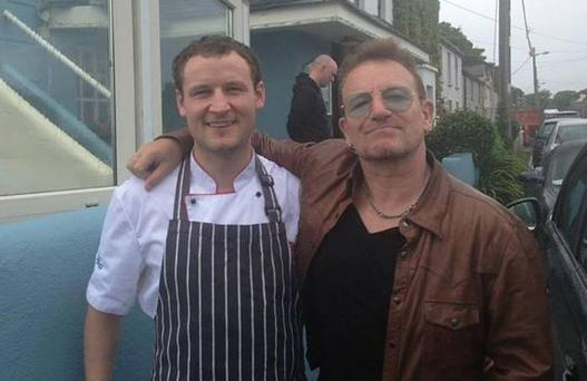 Bono has a pint of the black stuff at O'Grady's on the Pier in Barna