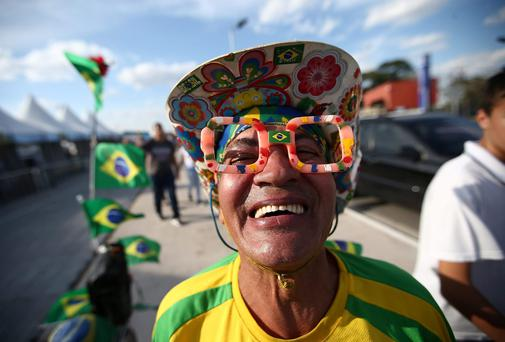 A Brazil fans poses outside of opening ceremony rehearsals around Itaquerao stadium, also known as Arena de Sao Paulo and Arena Corinthians in Sao Paulo, Brazil. Hundreds of fans turned up at the stadium to take a peek on the final Sunday before the opening of the 2014 FIFA World Cup match on June 12 between Brazil and Croatia.