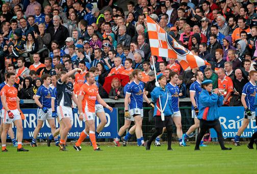 The Cavan and Armagh teams on parade after a pre-match altercation on Sunday. Photo: Oliver McVeigh / SPORTSFILE