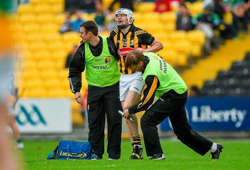 TJ Reid receives treatment before leaving the pitch during Kilkenny's Leinster SHC quarter-final against Offaly. Photo: Brendan Moran / SPORTSFILE