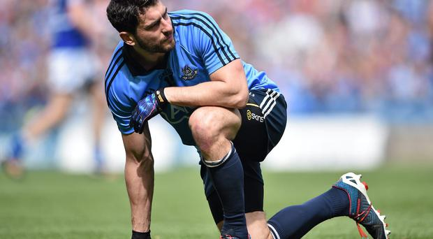 Bernard Brogan, pulls up with an injury during the first half of Dublin's match with Laois