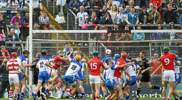 Cork and Waterford players tangle off the ball after Cork goalkeeper Anthony Nash had a penalty saved by Waterford goalkeeper Stephen O'Keeffe
