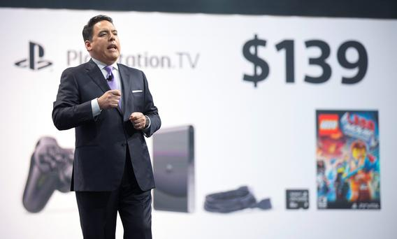 Shawn Layden, President and CEO of Sony Computer Entertainment America, presents the PlayStation TV during a media briefing before the opening day of the Electronic Entertainment Expo, or E3, at the Memorial Sports Arena in Los Angeles, California June 9, 2014. REUTERS/Mario Anzuoni