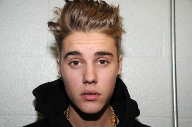 Singer Justin Bieber is photographed by police while in custody on January 23, 2014 in Miami Beach, Florida. Justin Bieber was arrested for driving under the influence, resisting arrest and driving without a valid driver's license