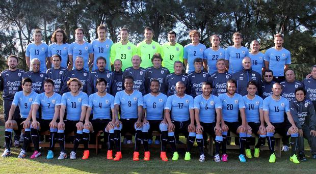 Uruguay's national soccer team players pose with members of the staff