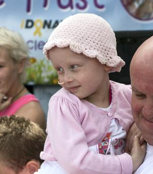 Little Molly Mc Nally with her Dad Gerry in Balscadden School at the Head Shave Event