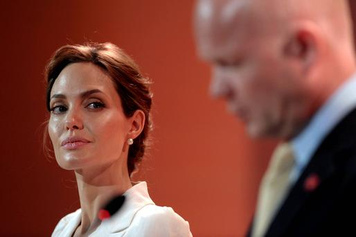 Actress and special envoy of the UN High Commissioner for Refugees (UNHCR), Angelina Jolie, and British Foreign Secretary William Hague make their opening speeches at a global summit to end sexual violence in conflict, in London. Reuters