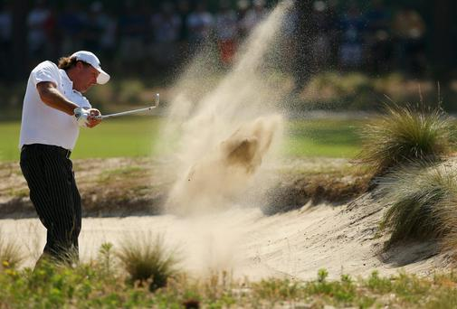 Phil Mickelson escapes from a bunker during his practice round for the 114th US Open at Pinehurst yesterday