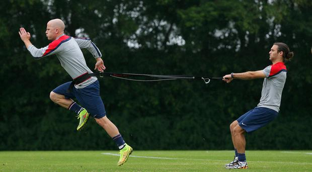 Michael Bradley and Graham Zusi of the United States work out during their training session at Sao Paulo FC in Sao Paulo, Brazil