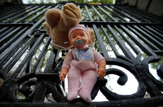A child's doll at the gates of Leinster House. Photo: PA