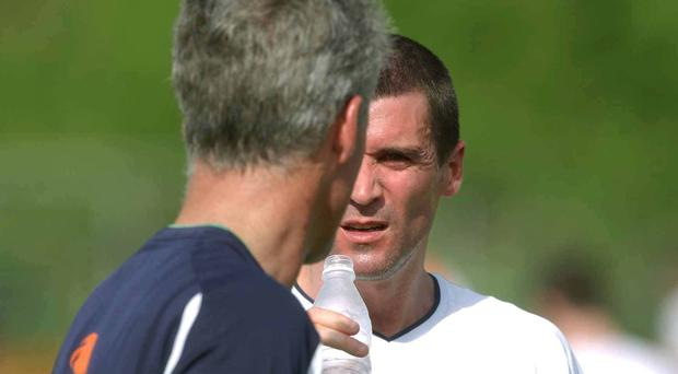 Former Republic of Ireland captain Roy Keane chats to manager Mick McCarthy during squad training for the 2002 World Cup