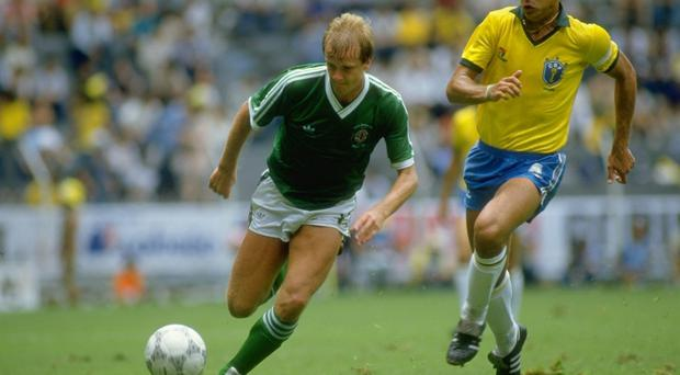 Colin Clarke (left) of Northern Ireland takes on Edhino Ibra of Brazil during the 1986 World Cup match at the Jalisco Stadium in Guadalajara, Mexico