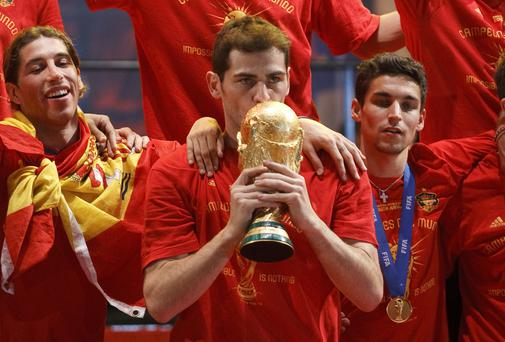 Spanish goalkeeper and capitain Iker Casillas kisses the World cup on a stage set up for the Spanish team victory ceremony in 2010 in Madrid, Spain