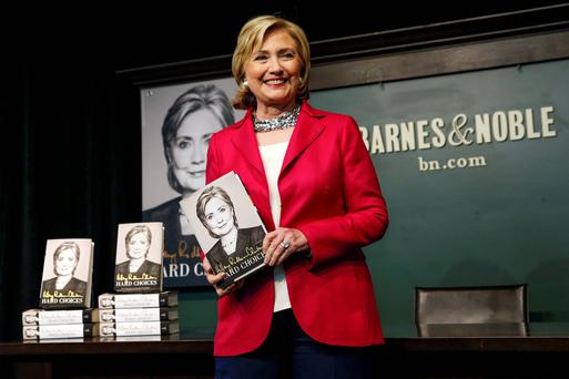 Hillary Clinton with a copy of her book in New York. Reuters