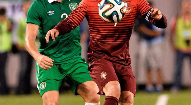 10 June 2014; Cristiano Ronaldo, Portugal, in action against Stephen Kelly, Republic of Ireland. Friendly International, Republic of Ireland v Portugal, MetLife Stadium, New Jersey, USA. Picture credit: David Maher / SPORTSFILE