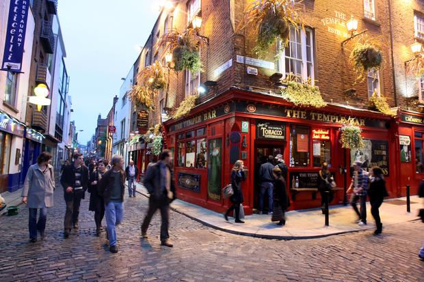 DUBLIN, IRELAND - OCTOBER 15: People walk past the Temple Bar pub in Temple Bar (Photo by Chris Jackson/Getty Images)