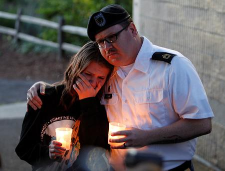 Supporters attend a candlelight vigil after a shooting at Reynolds High School in Troutdale, Oregon