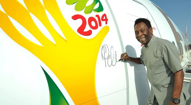 Emirates' Global Ambassador Pelé signs the first Boeing 777-300ER before it flies to São Paolo ahead of the 2014 FIFA World Cup™.