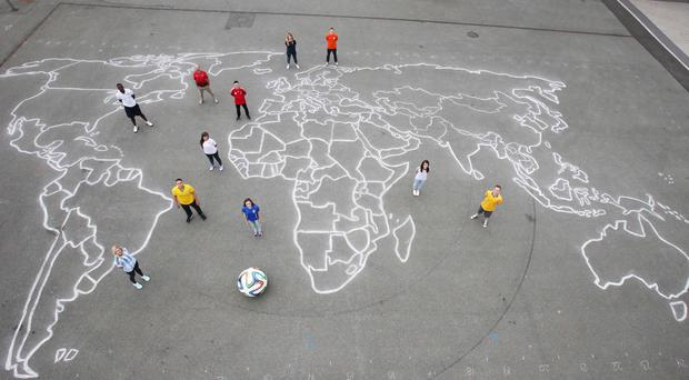 Standing on a giant chalk drawing of the world created by Irish artist, Sammy Kahlid. Photo: Leon Farrell/Photocall Ireland