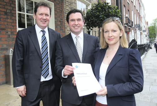 Terence Flanagan,TD (centre) with Lucinda CreightonTD and her husband Senator Paul Bradford (left) at the launch of the document on Political Reform by the Reform Alliance at a news conference in Dublin yesterday. Picture: Tom Burke