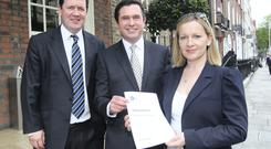Terence Flanagan,TD (centre) with Lucinda Creighton TD and her husband Senator Paul Bradford (left) at the launch of the document on Political Reform by the Reform Alliance at a news conference in Dublin yesterday. Picture: Tom Burke