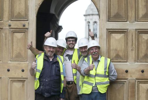 Builders Mark Corcoran,Mark Monney, Jonny King, Colm Guthrie and Ian Picket put the finishing touches to the Trinity Collage iconic wooden gates