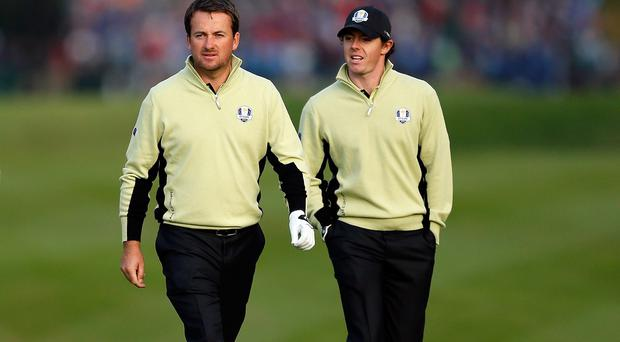 Graeme McDowell and Rory McIlroy. (Photo by Jamie Squire/Getty Images)