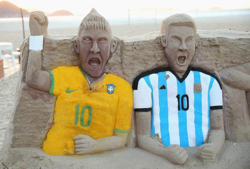 A sandcastle of Neymar of Brazil and Lionel Messi of Argentina on Copacabana beach in Rio de Janeiro, Brazil. (Photo by Julian Finney/Getty Images)