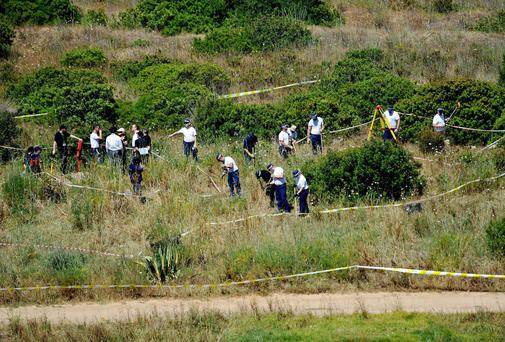 British police and their Portuguese counterparts investigating the disappearance of Madeleine McCann seven years ago from Praia da Luz on the Algarve, in Portugal during a search of a patch of scrubland just outside of the small coastal town as the search for clues enters a second week. Photo: Nick Ansell/PA Wire