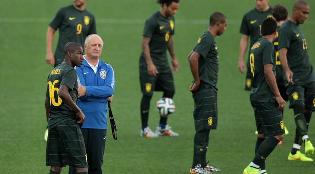 Manager Luiz Felipe Scolari of Brazil looks on with Ramires as the team walks around during a Brazil training session ahead of the 2014 FIFA World Cup Brazil opening match against Croatia at Arena de Sao Paulo in Sao Paulo, Brazil