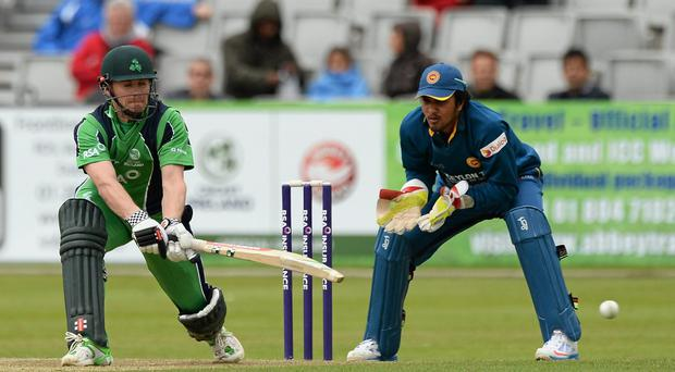 6 May 2014; Nial O'Brien, Ireland, sweeps the ball away from a delivery off Sachithra Senanayake, Sri Lanka. One Day International Cricket Match, Ireland v Sri Lanka, Castle Avenue, Clontarf, Co. Dublin. Picture credit: Oliver McVeigh / SPORTSFILE