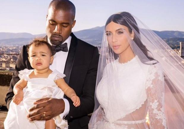 Proud mum Kim Kardashian has shared a family photo of herself with her new husband Kanye West and daughter North
