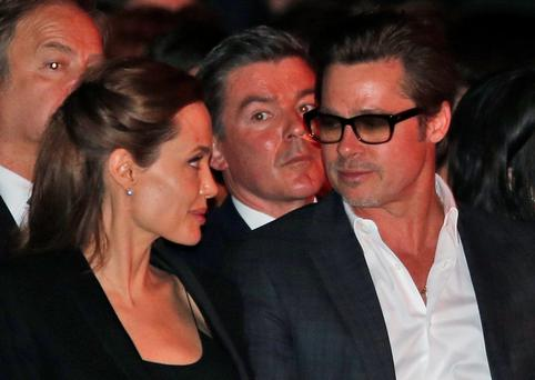 Angelina and Brad speak at the 'End Sexual Violence in Conflict' summit in London. (AP Photo/Lefteris Pitarakis)