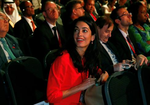 Barrister Amal Alamuddin, fiancee of actor George Clooney, at the summit. Reuters/Luke MacGregor