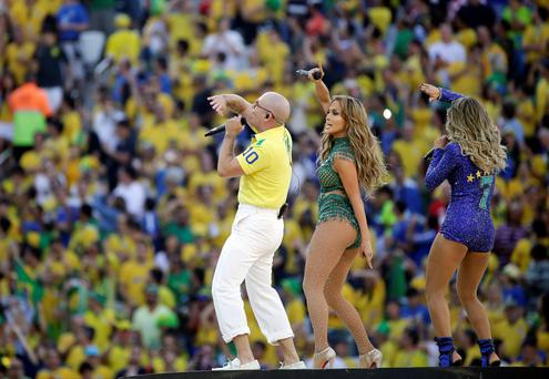 United States singer Jennifer Lopez, rapper Pitbull, and Brazilian singer Claudia Leitte perform during the opening ceremony ahead of the group A World Cup soccer match between Brazil and Croatia