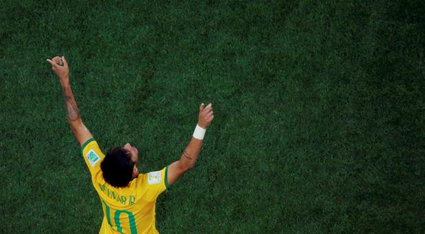 Brazil's Neymar celebrates after scoring against Croatia