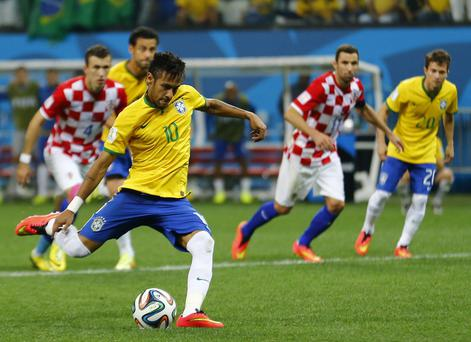 Brazil's Neymar scores from a penalty kick during the 2014 World Cup opening match between Brazil and Croatia