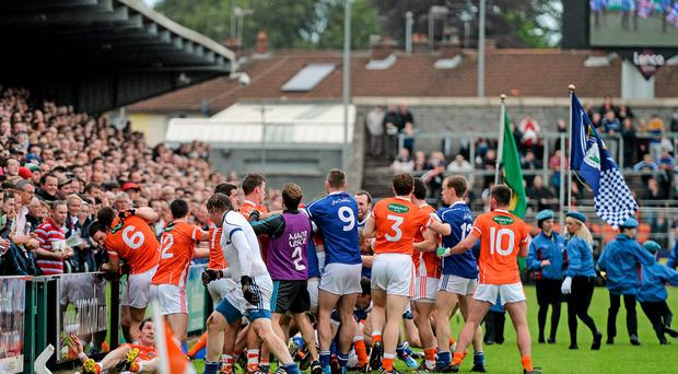 Armagh and Cavan players clash befpore their Ulster SFC quarter-final clash. Photo: Ramsey Cardy / SPORTSFILE