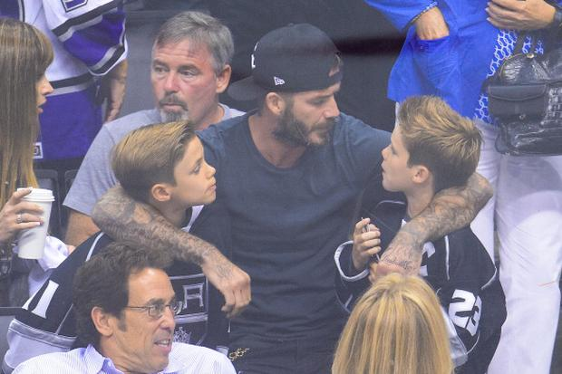 """David Beckham - Arguably the most famous """"stylish dad"""", the former England footballer turned one-half of the Beckham power brand has four children; Brooklyn (15); Romeo (11); Cruz (9) and Harper (2). David's off duty style has inspired countless men to invest in his staples- denim shirts, chunky cardigans and Ray Ban 'club master' sunglasses- though the verdict is still out on the hair band."""