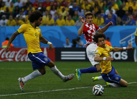 The real Marcelo scores an own goal as Croatia's Nikica Jelavic and Brazil's David Luiz look on