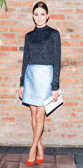 Style maven Olivia Palermo did not disappoint at a Victoria Beckham x Net-a-Porter dinner in New York. The socialite wore an iridescent lilac skirt and matching mid-night blue long-sleeved top. The former accessories editor of Elle Magazine teamed the look with a white envelope clutch and suede coral pumps.
